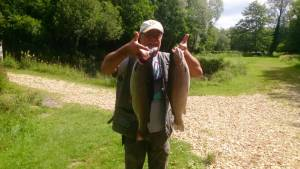 Mr Martyn Hocking with a 7lb from Pond and 5lb 12oz from Island.